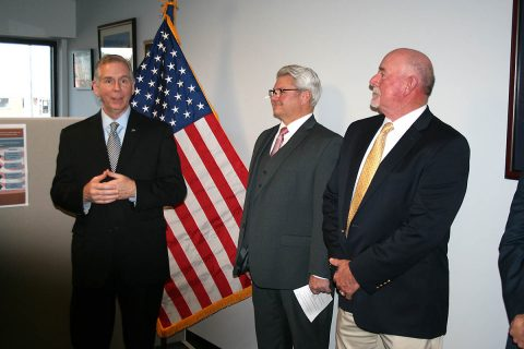 Clarksville Mayor Joe Pitts, joined by Executive Director Rory Mallory, and Robertson County Mayor Billy Vogle, speaks Tuesday at a gathering celebrating Fort Campbell Strong's first year and dedicating its new offices.