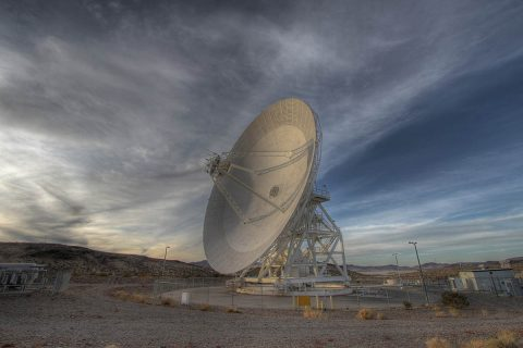 A Goldstone 111.5-foot (34-meter) beam-waveguide antenna tracks a spacecraft as it comes into view. The Goldstone Deep Space Communications Complex is located in the Mojave Desert in California. Engineers at NASA's Jet Propulsion Laboratory in Pasadena, California, will use antennas like this one to transmit a new set of commands to the Opportunity rover in an attempt to compel the 15-year-old Martian explorer to contact Earth. (NASA/JPL-Caltech)