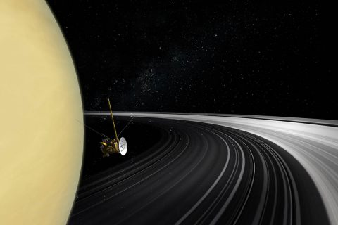 An artist's concept of the Cassini orbiter crossing Saturn's ring plane. New measurements of the rings' mass give scientists the best answer yet to the question of their age. (NASA/JPL-Caltech)