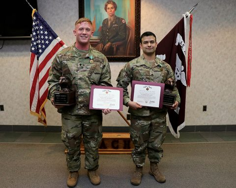 Spc. Robbie Brockman, a practical nursing specialist assigned to the hospital's Mother Baby Unit, and Staff Sgt. Robert Baker, a combat medic specialist serving as the non-commissioned officer in charge of BACH's Mother Baby Unit, were named Blanchfield Army Community Hospital Soldier and NCO of the Year at an award ceremony Jan. 17. (U.S. Army photo by Maria Yager)