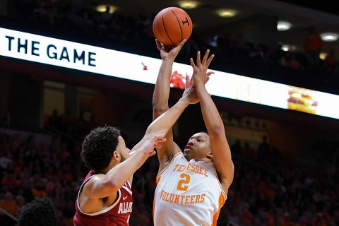 Tennessee Volunteers forward Grant Williams (2) shoots the ball against Alabama Crimson Tide forward Alex Reese (3) during the second half at Thompson-Boling Arena. Tennessee won 71 to 68. (Randy Sartin-USA TODAY Sports)