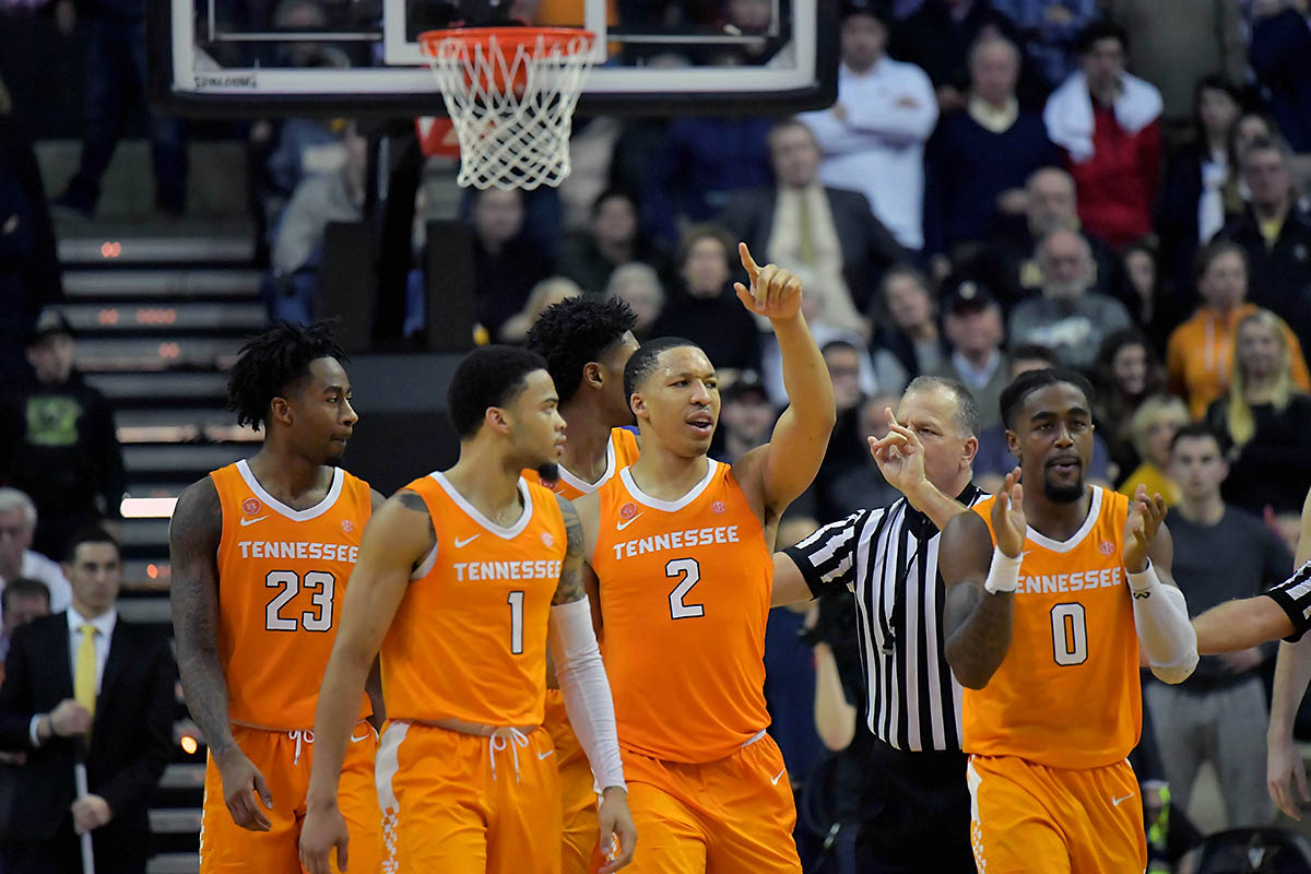 Tennessee Volunteers guard Jordan Bowden (23) and guard Lamonte Turner (1) and forward Grant Williams (2) and guard Jordan Bone (0) react during overtime against the Vanderbilt Commodores at Memorial Gymnasium. Tennessee won 88-83. (Jim Brown-USA TODAY Sports)