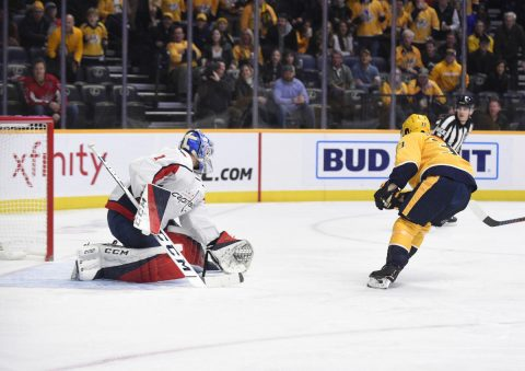 Jan 15, 2019; Nashville, TN, USA; Nashville Predators right wing Viktor Arvidsson (33) scores a goal against Washington Capitals goaltender Pheonix Copley (1) during the first period at Bridgestone Arena. Mandatory Credit: Steve Roberts-USA TODAY Sports