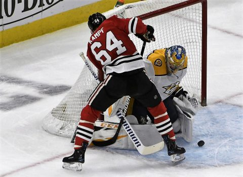 Jan 9, 2019; Chicago, IL, USA; Nashville Predators goaltender Pekka Rinne (35) makes a save on Chicago Blackhawks center David Kampf (64) during the first period at United Center. Mandatory Credit: David Banks-USA TODAY Sports