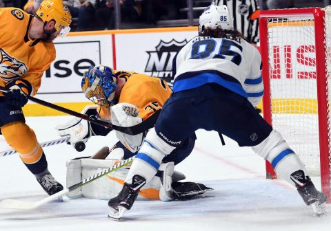 Jan 17, 2019; Nashville, TN, USA; Nashville Predators goaltender Pekka Rinne (35) makes a save on a shot by Winnipeg Jets left wing Mathieu Perreault (85) during the second period at Bridgestone Arena. Mandatory Credit: Christopher Hanewinckel-USA TODAY Sports
