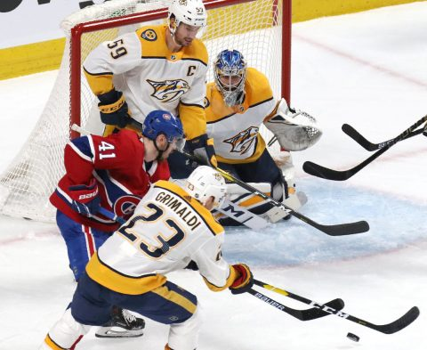 Nashville Predators center Rocco Grimaldi (23) and Montreal Canadiens left wing Paul Byron (41) battle for the puck in front of goaltender Juuse Saros (74) during the first period at Bell Centre. (Jean-Yves Ahern-USA TODAY Sports)