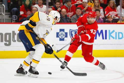 Jan 4, 2019; Detroit, MI, USA; Detroit Red Wings left wing Darren Helm (43) takes a shot defended by Nashville Predators defenseman Roman Josi (59) in the second period at Little Caesars Arena. Mandatory Credit: Rick Osentoski-USA TODAY Sports