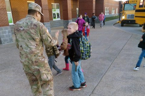 Spc. Raul Hernandez, an infantryman with C Co., 1st Battalion, 187th Infantry Regiment, 3rd Brigade Combat Team, greets South Christian students as they arrive for school in the morning. (U.S. Army Photo by 1st Lt. John Radigan)