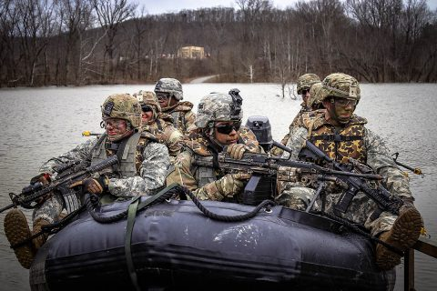 "Scouts of Charlie Troop ""Shadow"", 1st Squadron, 33rd Cavalry Regiment, 3rd Brigade Combat Team, 101st Airborne Division, prepare to embark upon a patrol along the Porter River at the Fort Knox Riverine Range, Fort Knox, KY, Jan 28th (U.S. Army Photo by Sgt. Aaron Daugherty)"
