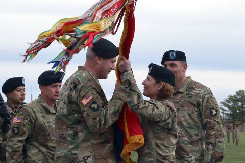 "Lt. Gen. Laura Richardson, acting commanding general for U.S. Forces Command, hands the ""Screaming Eagle"" colors to Maj. Gen. Brian Winski, as he assumes command of the 101st Airborne Division (Air Assault), Feb. 14, at Fort Campbell, Kentucky. Winski succeeds Maj. Gen. Andrew Poppas, who, after commanding the world's only air assault division for the past two years, will move on to the Pentagon, as the director of operations for the Joint Staff. (Sgt. James Griffin, 1st Brigade Combat Team, 101st Airborne Division Public Affairs)"