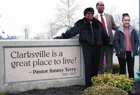 Servella Terry, wife of the late Pastor Jimmy Terry; his son, Jimmy Terry, and his daughter, Londyn; gather around the monument unvieled Friday.