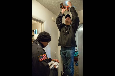 Clarksville Fire Rescue personnel install a smoke alarm at a local residence. Fire Rescue and the State Fire Marshal's Office offer the smoke alarms to qualifying households who apply for the free service. (Capt. Michael Rios, Clarksville Fire Rescue)