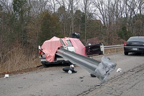 Clarksville Police respond to a Cooper Mini that crashed into a guard rail on Kennedy Lane.