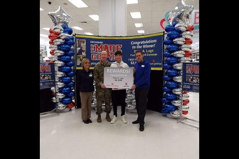 Garrison Command Sgt. Maj. Jason W. Osborne joins the Fort Campbell Exchange Store Manager Annette Montgomery and General Manager David Swenson in celebrating Elias Lugo, 14, of Clarksville, TN for his academic achievement. Elias was presented with a $2,000 Exchange gift card Feb. 1 as part of the You Made the Grade program. (Army & Air Force Exchange Service HQ)