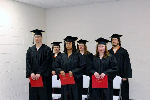 Audrey Clevenger, Kymber Green, Paul Murphy, Rachel Parson, Tabitha Kirk, and Andy Travis receive their high school equivalency diplomas.
