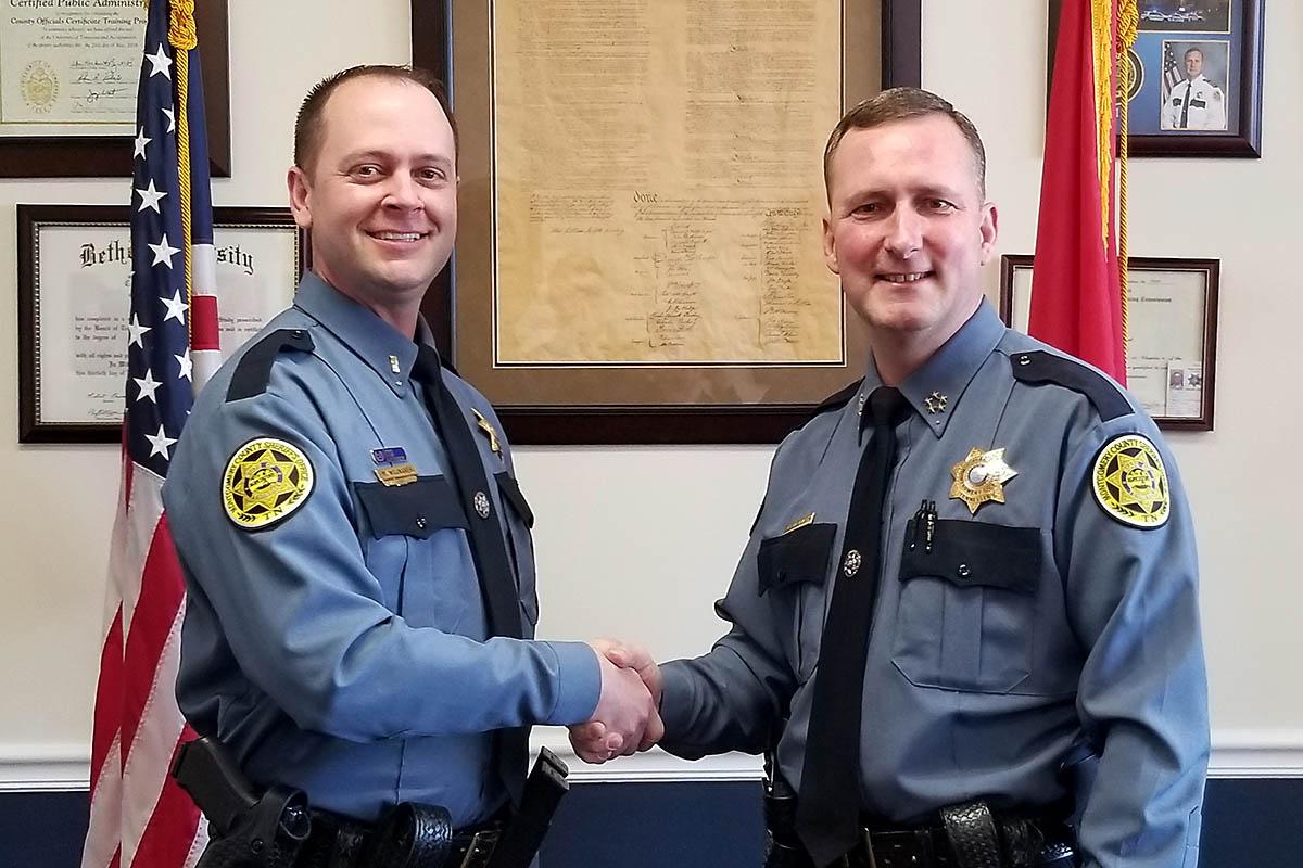 Montgomery County Sheriff John Fuson (L) congratulates Mark Wojnarek (R) on his promotion to Lieutenant.
