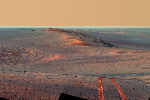 This scene from the panoramic camera on NASA's Mars Exploration Rover Opportunity looks back toward part of the west rim of Endeavour Crater that the rover drove along, heading southward, during the summer of 2014. (NASA/JPL-Caltech/Cornell/ASU)