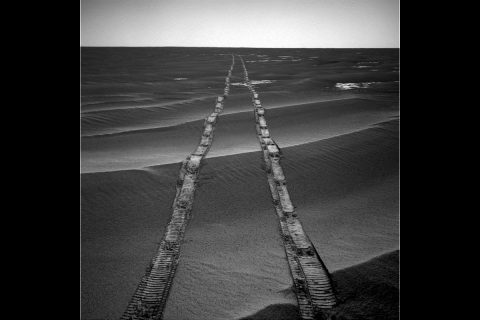 In this navigation camera raw image, NASA's Opportunity Rover looks back over its own tracks on Aug. 4, 2010. NASA's Jet Propulsion Laboratory, a division of Caltech in Pasadena, manages the Mars Exploration Rover Project for NASA's Science Mission Directorate, Washington.
