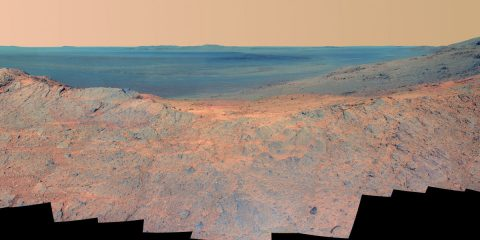 """This May 14, 2014, scene from the Pancam on NASA's Mars Exploration Rover Opportunity catches """"Pillinger Point,"""" on the western rim of Endeavour Crater, in the foreground and the crater's eastern rim on the horizon. (NASA/JPL-Caltech/Cornell Univ./Arizona State Univ.)"""