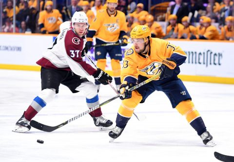 Feb 23, 2019; Nashville, TN, USA; Nashville Predators right wing Viktor Arvidsson (33) passes the puck during the first period against the Colorado Avalanche at Bridgestone Arena. Mandatory Credit: Christopher Hanewinckel-USA TODAY Sports