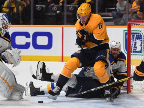 Feb 10, 2019; Nashville, TN, USA; Nashville Predators center Kyle Turris (8) battles for a loose puck behind St. Louis Blues goaltender Jake Allen (34) during the third period at Bridgestone Arena. Mandatory Credit: Christopher Hanewinckel-USA TODAY Sports