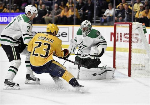 Dallas Stars goaltender Anton Khudobin (35) blocks the shot of Nashville Predators center Rocco Grimaldi (23) during the first period at Bridgestone Arena. (Steve Roberts-USA TODAY Sports)