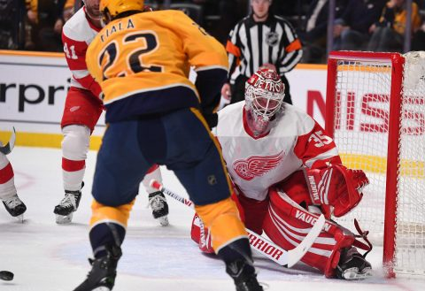 Feb 12, 2019; Nashville, TN, USA; Detroit Red Wings goaltender Jimmy Howard (35) makes a save on a shot by Nashville Predators left wing Kevin Fiala (22) during the first period at Bridgestone Arena. Mandatory Credit: Christopher Hanewinckel-USA TODAY Sports