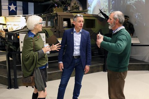 Dr. John O'Brian (right), director of the Don F. Pratt Memorial Museum, conducts a tour of the museum on Fort Campbell, Feb. 25, for Helen Ayer Patton (left), granddaughter of the legendary Gen. George S. Patton, Jr., and Hans Van Kessel (center) curator for the 101st Airborne Museum Le Mess in Bastogne, Belgium. (Sgt. James Griffin, 1st Brigade Combat Team Public Affairs)