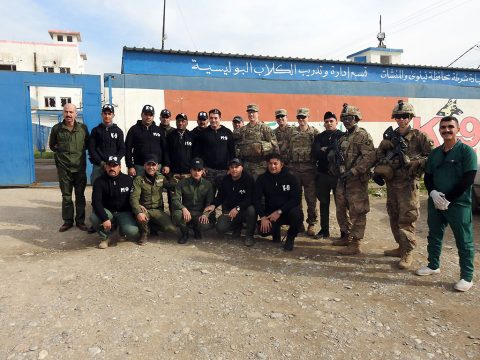 U.S. Army Soldiers from HHC and C Co 1-327 IN with their Iraqi Police Counterparts. 1-327 IN is advising and assisting Mosul Police to improve their facilities and the use of available training. The relationship between the K9 unit and their Coalition advisors is important to ensure successful checkpoint operations. (1st Brigade Combat Team, 101st Airborne Division)