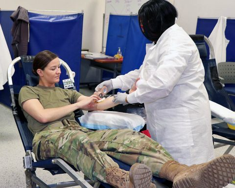 Armed Services Blood Program Phlebotomist Tracey Toomer, places a dressing on 1st Lt. Shelbea Treanor's arm after Treanor donated blood to the Armed Services Blood Program. Treanor, assigned to 1st Squadron, 32nd Cavalry Regiment, 1st Brigade Combat Team, 101st Airborne Division, was one of many participants who supported the ASBP blood drive last December. (U.S. Army photo by Maria Yager.)
