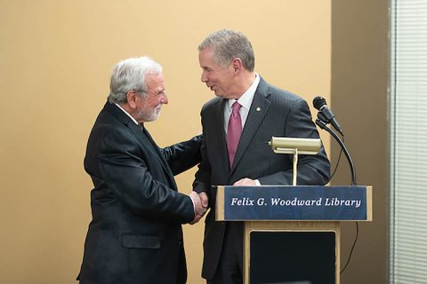 Clarksville Mayor Joe Pitts honors retired Austin Peay State University professor Glenn Carter for his service to APSU.