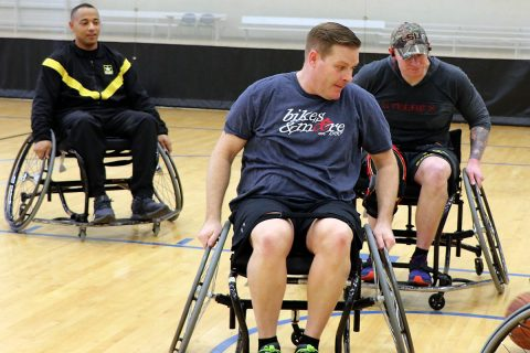 (L to R) Staff Sgt. Kenneth Arnold, Sgt. 1st Class Ian Crawley, and Sgt. 1st Class Joseph Fontenot, all assigned to Fort Campbell's Warrior Transition Battalion, practice moving down the court during a round of wheelchair basketball at Shaw Gym Feb. 28. The Soldiers will be competing in the Army Trials at Fort Bliss, Texas, this week, to earn a spot on Team Army for the 2019 Warrior Games later this year. (U.S. Army photo by Maria Yager)