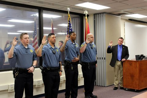 Montgomery County Sheriff John Fuson swears in Andrew Brown, Tyler Cunningham, Dexter Pendleton-Clark, and Joshua Williams.
