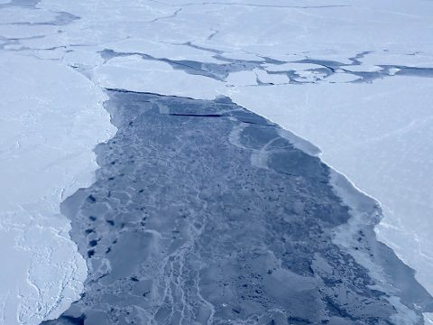 A big lead, or opening in the sea ice pack, in the eastern Beaufort Sea, as seen from a NASA Operation IceBridge survey flight on Apr. 14, 2018. (NASA/Joe MacGregor)