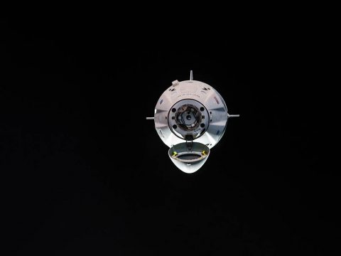 The uncrewed SpaceX Crew Dragon spacecraft is the first Commercial Crew vehicle to visit the International Space Station. Here it is pictured with its nose cone open revealing its docking mechanism while approaching the station's Harmony module on March 3rd, 2019. (NASA)