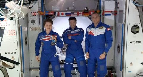 Expedition 58 crew members Anne McClain, David Saint-Jacques and Oleg Konenenko welcome the SpaceX Crew Dragon to the International Space Station after a successful docking on March 3, 2019, ushering in the era of NASA's Commercial Crew Program. (NASA TV)
