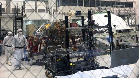 Technicians working Mars 2020's System's Test 1 approach their workstation in the Spacecraft Assembly Facility at NASA's Jet Propulsion Laboratory in Pasadena, California. (NASA/JPL-Caltech)