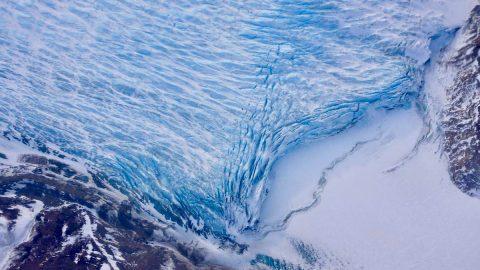 Cracks in the front of a glacier as it reaches the ocean. (NASA/Adam Klein)