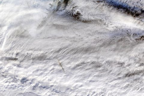 NASA's MODIS instrument, aboard the Terra satellite, captured this true-color image showing the remnants of a meteor's passage, seen as a dark shadow cast on thick, white clouds on Dec. 18, 2018. (NASA GSFC)