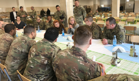 Senator Marsha Blackburn sits down and has lunch with some of the soldiers.