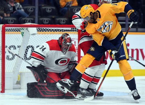 Mar 9, 2019; Nashville, TN, USA; Nashville Predators right wing Wayne Simmonds (17) tries to deflect a shot on Carolina Hurricanes goaltender Petr Mrazek (34) during the second period at Bridgestone Arena. Mandatory Credit: Christopher Hanewinckel-USA TODAY Sports
