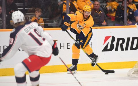 Nashville Predators defenseman Roman Josi (59) passes the puck from behind his net during the first period against the Columbus Blue Jackets at Bridgestone Arena. (Christopher Hanewinckel-USA TODAY Sports)