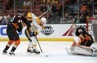 March 12, 2019; Anaheim, CA, USA; Nashville Predators center Nick Bonino (13) moves in on goal against Anaheim Ducks defenseman Jacob Larsson (32) and goaltender John Gibson (36) during the first period at Honda Center. Mandatory Credit: Gary A. Vasquez-USA TODAY Sports