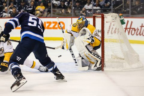 Mar 1, 2019; Winnipeg, Manitoba, CAN; Winnipeg Jets forward Mark Scheifele (55) scores a goal past Nashville Predators goalie Pekka Rinne (35) during the second period at Bell MTS Place. Mandatory Credit: Terrence Lee-USA TODAY Sports