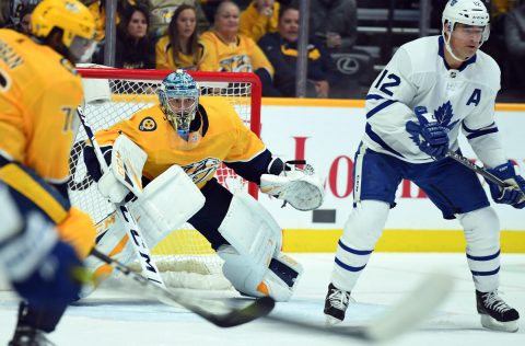 Mar 19, 2019; Nashville, TN, USA; Nashville Predators goaltender Pekka Rinne (35) watches the puck behind Toronto Maple Leafs center Patrick Marleau (12) during the first period at Bridgestone Arena. Mandatory Credit: Christopher Hanewinckel-USA TODAY Sports