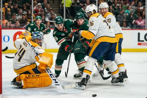 Mar 25, 2019; Saint Paul, MN, USA; Nashville Predators goalie Juuse Saros (74) makes a save in front of Minnesota Wild forward Luke Kunin (19) during the second period at Xcel Energy Center. Mandatory Credit: Brace Hemmelgarn-USA TODAY Sports