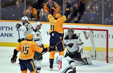 Mar 5, 2019; Nashville, TN, USA; (Editors Note: Corrected Caption) Nashville Predators center Brian Boyle (11) celebrates in front of Minnesota Wild goaltender Devan Dubnyk (40) after scoring a goal during the second period at Bridgestone Arena. The goal was originally credited to Nashville Predators defenseman P.K. Subban (76) but was changed by officials to Boyle in the third period. Mandatory Credit: Christopher Hanewinckel-USA TODAY Sports