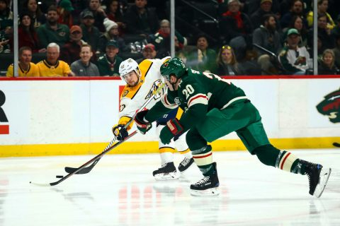 Mar 3, 2019; Saint Paul, MN, USA; Nashville Predators right wing Viktor Arvidsson (33) shoots the puck against Minnesota Wild defenseman Ryan Suter (20) in the first period at Xcel Energy Center. Mandatory Credit: David Berding-USA TODAY Sports