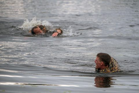 "Capts. Michael Rose, left, and John Bergman swim across Victory Pond April 12 during the 2019 Best Ranger Competition. Bergman and Rose of the 101st Airborne Division, Fort Campbell, Kentucky, earned the title of ""Best Rangers"" during an awards ceremony at the Maneuver Center of Excellence headquarters April 15 at Fort Benning. (U.S. Army photo by Patrick Albright, Fort Benning Public Affairs)"