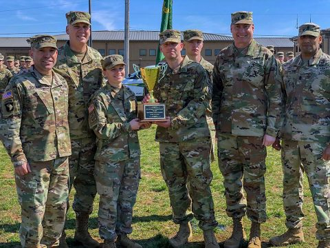 Leaders from the 716th Military Police Battalion and Office of the Provost Marshal General hold the J.P. Holland Award trophy with pride in front of a formation with the 551st Military Police Company. From left to right, Lt. Col. S. Joel Schuldt, 716th Military Police Battalion, Commander; Maj. General David Glaser, Provost Marshal General; Capt. Katie Troxell, 551st Military Police Company, commander; 1st Sgt. Jason Kaack, 1st Sgt. 551st Military Police Company; Sgt. Maj. Larry Orvis, Provost Marshal Sgt. Maj.; Command Sgt. Maj. Jose Shorey, senior enlisted advisor for 716th MP Bn. (1st Lt. Matthew Murphy, 551st MP Co. UPAR)